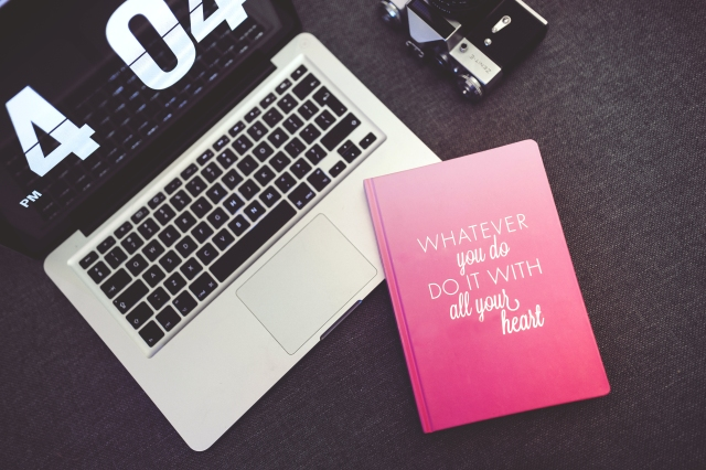 kaboompics.com_Pink Notebook with sentence and Apple Macbook